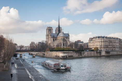 Crossing the bridge to Ile-Saint-Louis, catching the Bateaux Mouches and the Notre Dame in the background...