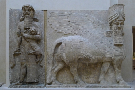 Assyrian human-headed winged bull with another who's got an unhappy kitty
