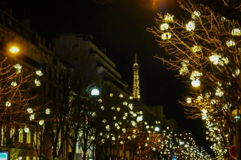 Beautifully lit street off the Champs-Élysées, with the Eiffel Tower in the background