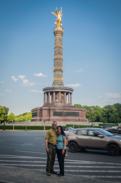 Mom and Dad Stand in Front of the Victory Column