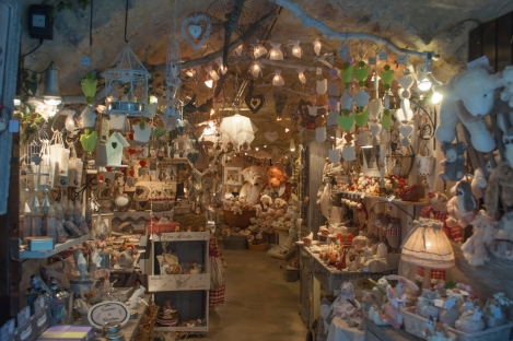 An inviting shop full of stuffed animals and teddy  bears...