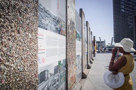 Thelma looks at what remains of the Berlin Wall
