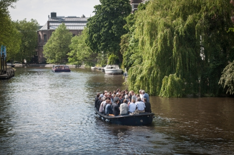 How many businessmen can fit in one boat?