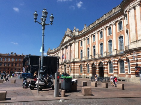 "The Mairie (Mayor's Office) of Toulouse - There was the ""Fete de la Musique"", France's national day to celebrate music, so that's why there's a big stage blocking the entrance"